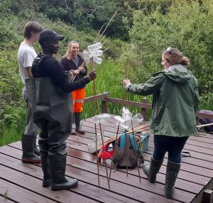 ecologists at a pond